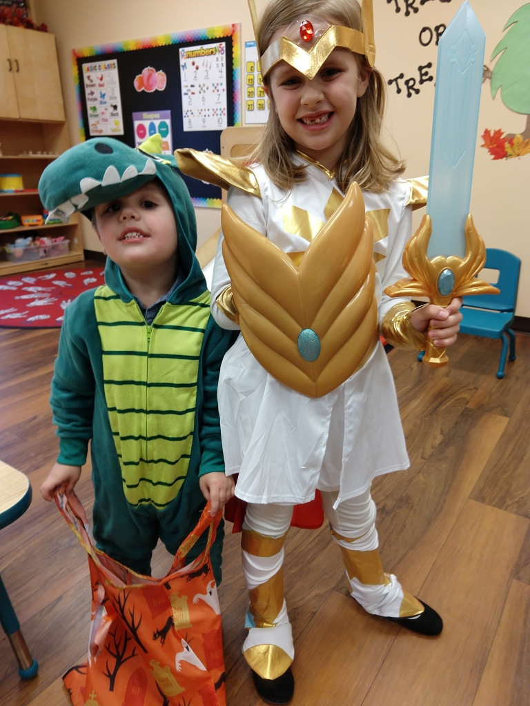Felicity is She-Ra. Henry is a dinosaur.